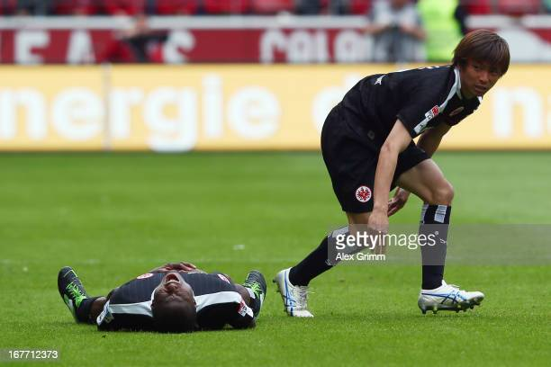 Constant Djakpa and Takashi Inui of Frankfurt react during the Bundesliga match between 1 FSV Mainz 05 and Eintracht Frankfurt at Coface Arena on...