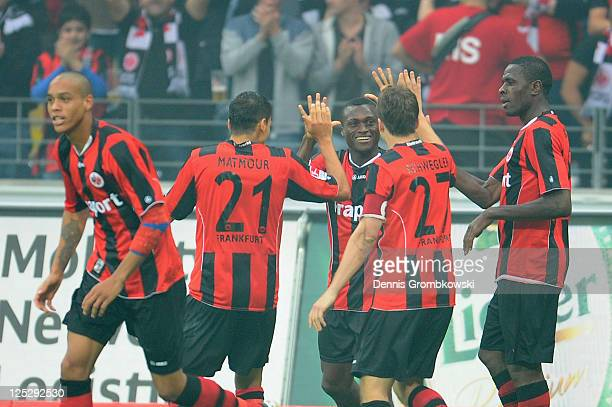 Constant Djakpa of Frankfurt celebrates with team mates after scoring his team's second goal during the Second Bundesliga match between Eintracht...