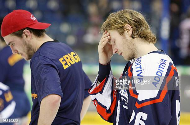 Constantin Braun and team mate Florian Busch of Berlin look dejected after loosing the fifth DEL quarter final playoff game between Eisbaeren Berlin...