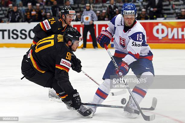 Constantin Braun of Germany blocks a shot by Tomas Starosta of Slovakia during the IIHF World Championship qualification round match between Slovakia...
