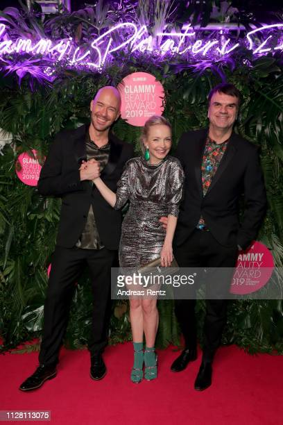 Constantin Herrmann, Janin Ullmann and Glamour publisher Andre Pollmann at the Glammy Award on February 07, 2019 in Munich, Germany.