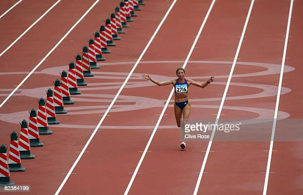 Constantina Tomescu of Romania completes her final lap in the Women's Marathon Final at the National Stadium on Day 9 of the Beijing 2008 Olympic...