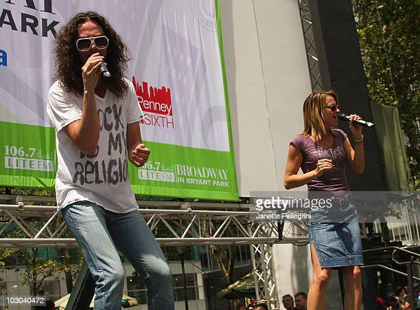 Constantine Maroulis and Emily Padgett from the cast of Rock of Ages perform at 1067 Lite FM presents Broadway in Bryant Park on July 22 2010 in New...