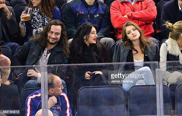 Constantine Maroulis guest and Vika Levina attend the Detroit Red Wings vs New York Rangers game at Madison Square Garden on January 16 2014 in New...