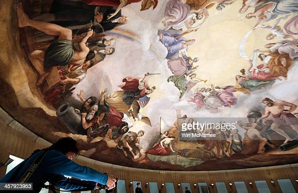 Constantino Brumidi's painting of the Apotheosis of Washington is shown on the ceiling of the US Capitol's rotunda during a media tour December 19...