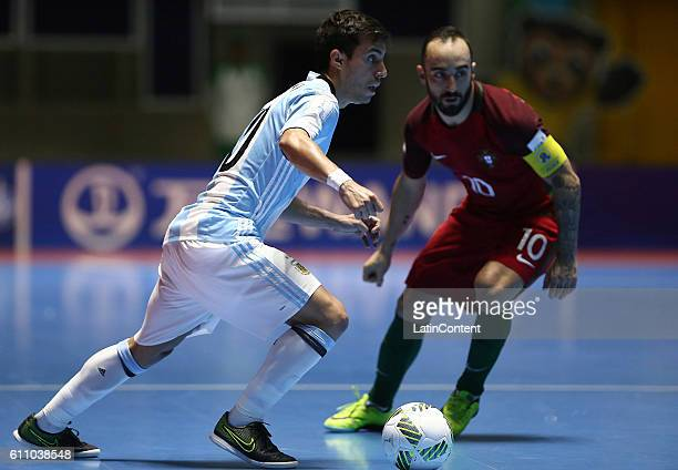Constantino Vaporaki of Argentina vies for the ball with Ricardinho of Portugal during a semi final match between Argentina and Portugal as part of...