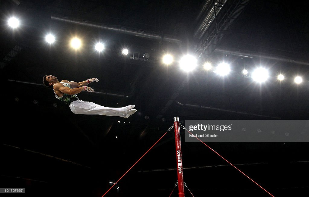 Constantinos Aristotelous of Cyprus in action on the high bar as he competes in the Men's Artistic Gymnastics Qualification at IG Sports Complex during day one of the Delhi 2010 Commonwealth Games on October 4, 2010 in Delhi, India. Cyprus were second in the qualifiers behind Wales.