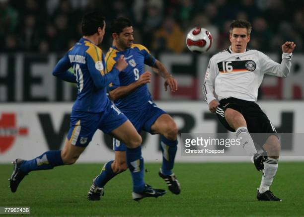Constantinos Charalambides and Ioannis Okkas od Cyprus tackles Philipp Lahm of Germany during the UEFA Euro2008 Group D qualifying match between...
