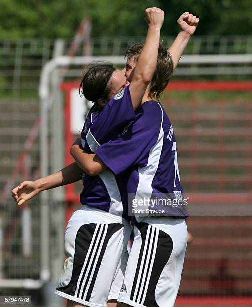 Constanze Hess of TeBe Berlin and her team mate Jana Theodoridis celebrate the third goal during the Women's Second Bundesliga match between Tennis...