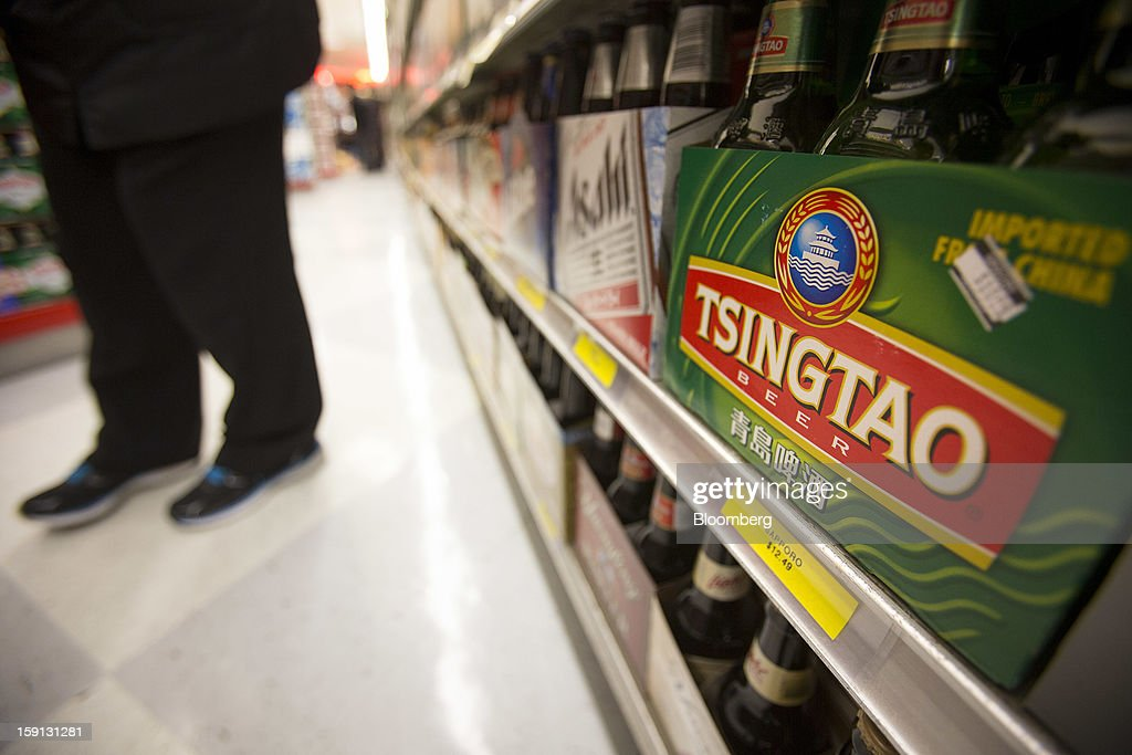 Constellation Brands Inc. Tsingtao beer is displayed for sale at a grocery store in New York, U.S., on Tuesday, Jan. 8, 2013. Constellation Brands Inc (STZ US) was rated new 'Buy' at ISI Group by equity analyst Robert Ottenstein. The 12-month target price is $43.00 per share. Photographer: Scott Eells/Bloomberg via Getty Images