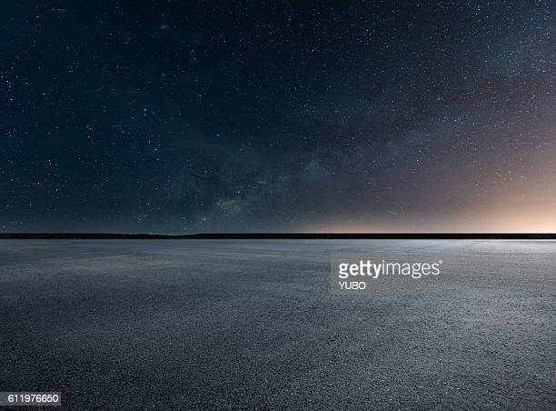 constellation of stars in sky - horizon over land stock photos and pictures