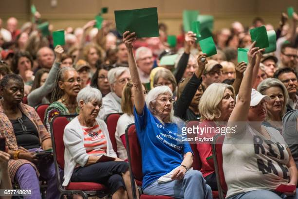 Constituents agree with Sen. Lindsey Graham during a town hall meeting March 25, 2017 in Columbia, South Carolina. Protestors have been showing up in...