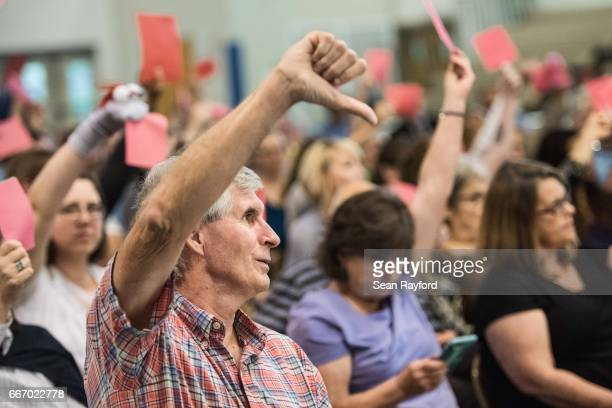 Constituents disagree with Rep. Joe Wilson during a town hall meeting April 10, 2017 at Aiken Technical College in Graniteville, South Carolina....