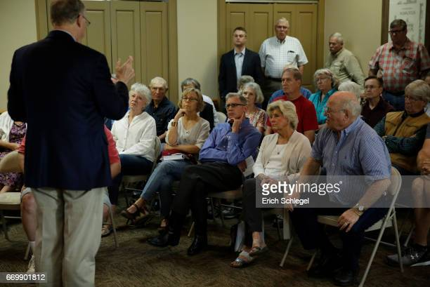 Constituents listen as US Rep Mike Conaway holds a town hall meeting at the Mason County Library on April 18 2017 in Mason Texas Conaway is replacing...