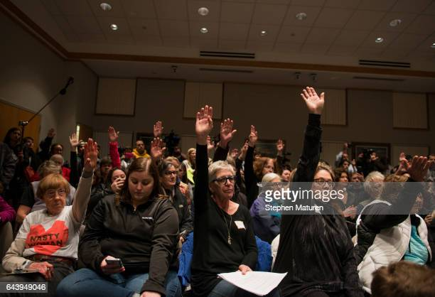 Constituents of Minnesota's 6th District raises their hand to ask a question of Rep Tom Emmer at a town hall meeting on February 22 2017 in Sartell...