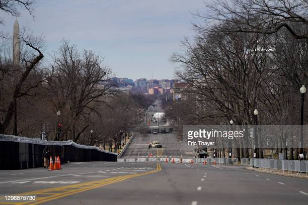 Constitution Avenue is nearly deserted next to the U.S. Capitol building, with the Washington Monument at left, on January 17, 2021 in Washington,...