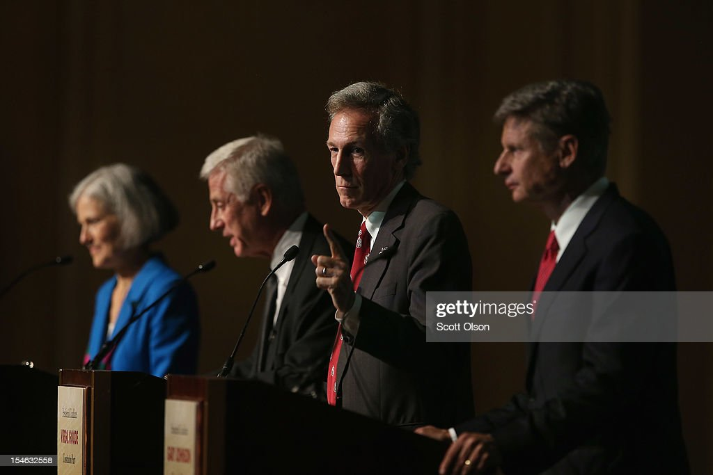 Constitution Party presidential candidate Virgil Goode (2nd R) makes a point as Jill Stein (L) from the Green Party, Rocky Anderson (2nd L) from the Justice Party and Gary Johnson (R) from the Libertarian Party look on during a debate hosted by the Free and Equal Elections Foundation and moderated by former CNN talk-show host Larry King on October 23, 2012 in Chicago, Illinois. The 90-minute debate held at the Chicago Hilton hotel featured presidential candidates from the Green Party, Libertarian Party, Constitution Party and Justice Party.