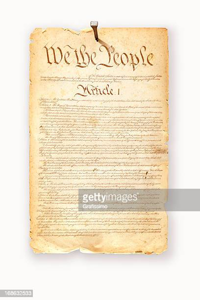 constitution usa fixed with nail on white background - bill of rights stock photos and pictures