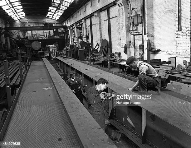 Constructing an overhead crane Wombwell Foundry near Barnsley South Yorkshire 1963 One worker who looks like he would be more at home in a school...