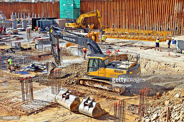 constructing the concrete and steel foundations for a highrise building - crane construction machinery stock pictures, royalty-free photos & images