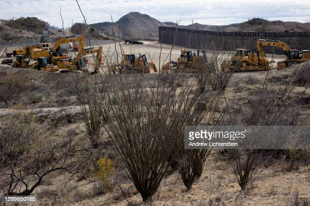 Construction along the new United States-Mexican border wall built under President Trump has halted approximately fifteen miles east of Sasabe, as...