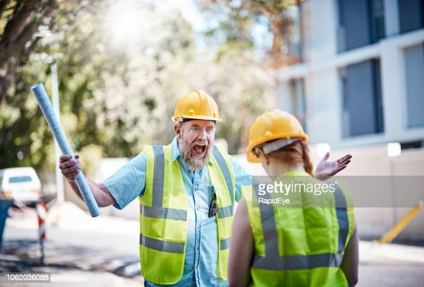 construction boss yelling at penitent female worker - foreman stock pictures, royalty-free photos & images