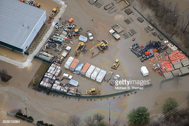 A construction business is seen submerged in floodwater on December 31 2015 in Eureka Missouri The St Louis area and surrounding region are...