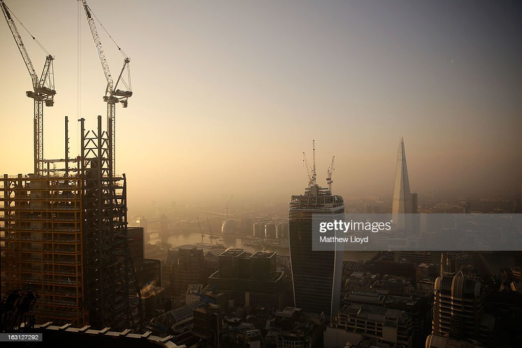 Construction continues at 122 Leadenhall Street (L), nicknamed the Cheese Grater, and 20 Fenchurch Street (C), nicknamed the Walkie-Talkie in front of the Shard (R) on March 5, 2013 in London, England. The recent construction of numerous tall buildings on the London skyline has been controversial due to concerns that views of historic landmark buildings, such as St Paul's cathedral, are being obscured.