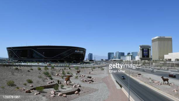 Construction continues at Allegiant Stadium the USD 2 billion glassdomed future home of the Las Vegas Raiders west of a marquee at Mandalay Bay...