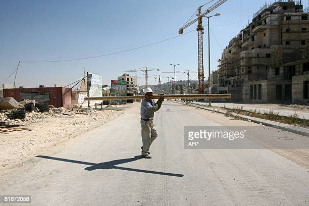 Construction continues in the Jewish settlement of Har Homa in east Jerusalem on July 9 2008 An Israeli commission has approved the building of 920...