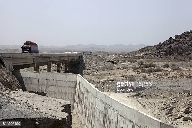 Construction continues near a bridge on the M8 motorway on the outskirts of Gwadar, Balochistan, Pakistan, on Wednesday, Aug. 3, 2016. Gwadar is the...