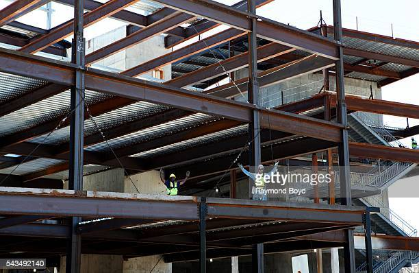 Construction continues on Little Caesars Arena home of the Detroit Red Wings hockey team on June 17 2016 in Detroit Michigan