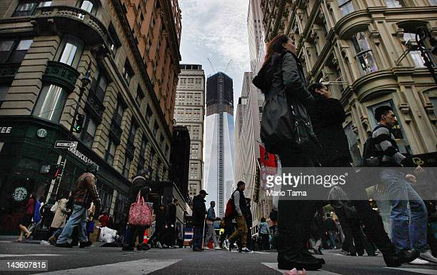 Construction continues on One World Trade Center after workers moved a steel column into place to make it New York City's tallest building on April...