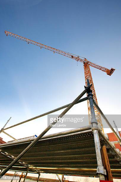 Construction crane and scaffolding