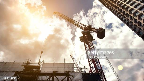 construction crane in the center of london, near the centrepoint highrise building in 1965. london, w1, england - rebuilding stock pictures, royalty-free photos & images