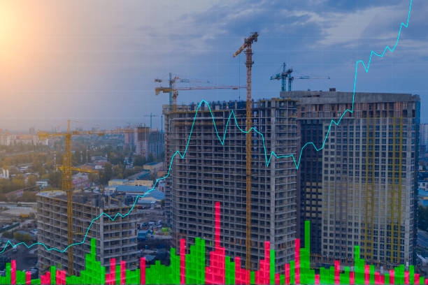 Construction crane on the background of stock charts. Real Estate Market