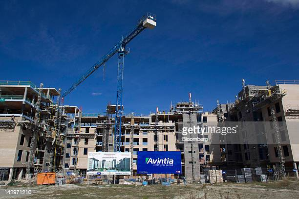 A construction crane operates at a development site for new apartments developed by Avintia Proyectos Y Construcciones SL in Madrid Spain on Monday...