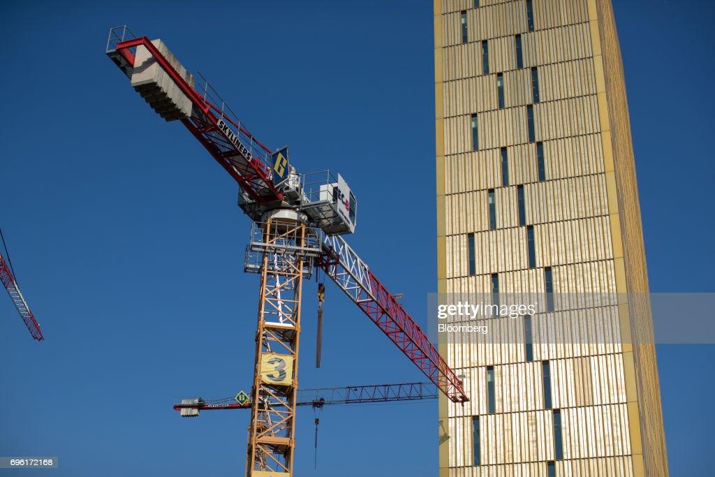 A construction crane stands beside the European Union Court