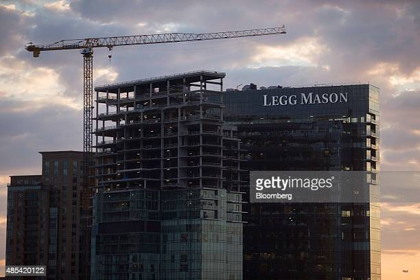 A construction crane stands near the Legg Mason Inc headquarters in Baltimore Maryland US on Wednesday Aug 26 2015 Home flippers turned a quick and...
