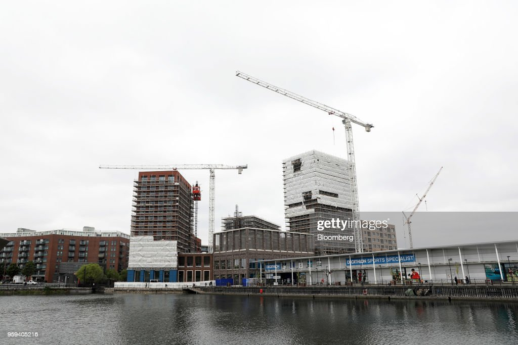 Construction cranes and a Decathlon SA sports a leisure store stand in the Canada Water area of south London, U.K., on Wednesday, May 16, 2018. British Land Co. will seek approval to develop as many as 3,000 homes and work space equivalent to almost four Gherkin skyscrapers on a plot in south Londons Canada Water. Photographer: Chris Ratcliffe/Bloomberg via Getty Images