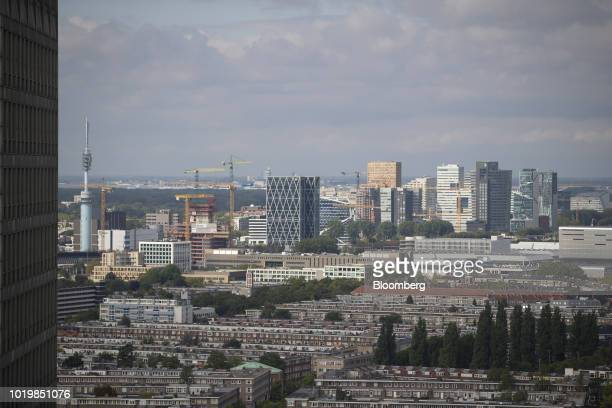 Construction cranes and skyscrapers stand on the skyline in the Zuidas financial district in Amsterdam Netherlands on Thursday Aug 16 2018 In...