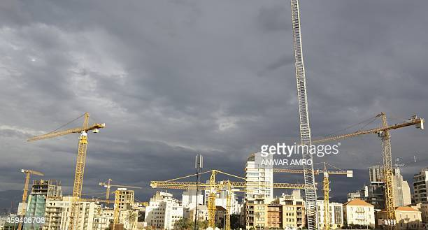 Construction cranes are seen in the Beirut skyline on November 22 2014 AFP PHOTO/ANWAR AMRO
