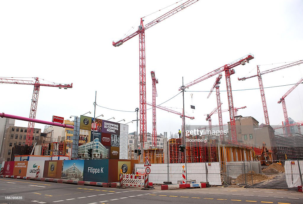 Construction cranes are seen on the building site for the Leipziger Platz shopping mall, Berlin's largest commercial project by developer High Gain House Investments GmbH (HGHI), in Berlin, Germany, on Wednesday, May 8, 2013. Germany, Europe's largest economy, reported growth in the construction industry during April, according to Markit Economics. Photographer: Krisztian Bocsi/Bloomberg via Getty Images