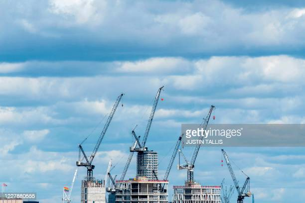 Construction cranes are seen over development works in central London on August 2 2020 Plans for a shakeup of a complex and outdated planning system...
