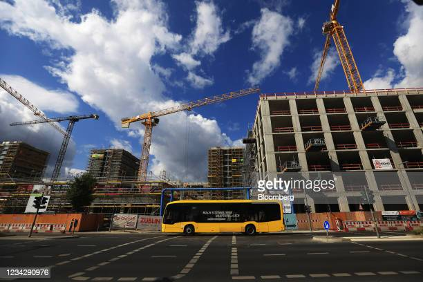 Construction cranes at the Quartier Heidestrasse residential building project in Berlin, Germany, on Thursday, July 29, 2021. Germany reports gross...