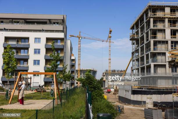 Construction cranes between new residential apartments and a housing construction site, on a plot of brownfield land in the Vysoany district in...