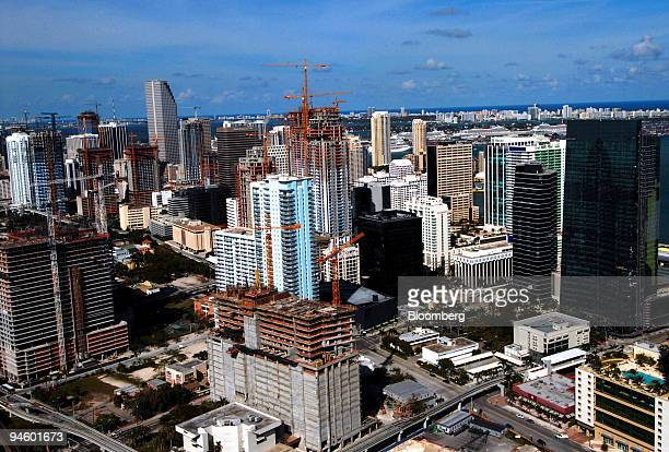 Construction cranes dot the skyline of Miami Florida Sunday March 11 2007 In the middle of the biggest glut of condominiums in more than 30 years...