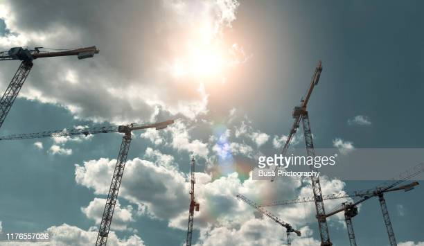 construction cranes in the center of berlin, germany - kran stock-fotos und bilder