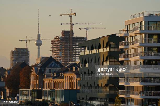 Construction cranes loom over new luxury apartment buildings and the Stream office building under construction as the broadcast tower at...