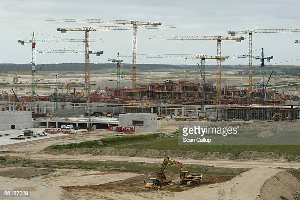 Construction cranes loom over the construction site of the new BBI Airport terminal on June 3 2009 in Berlin Germany The airport which will replace...